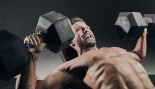 Man Performing Dumbbell Press  thumbnail