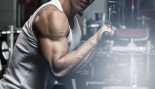 Man Performing Triceps Pushdown At Gym thumbnail
