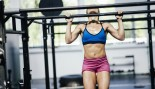 Woman performing pullup at the gym thumbnail