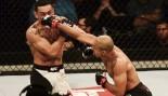 Jose Aldo of Brazil punches Max Holloway. thumbnail