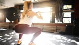 Woman Does Barbell Squat thumbnail