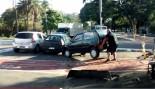 man lifts car thumbnail