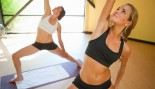 two women doing yoga poses thumbnail