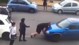 A Furious Turkish Hulk Casually Manhandles a Neighbors Car Over a Parking Dispute thumbnail