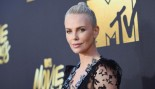 Charlize Theron posing on the red carpet.  thumbnail