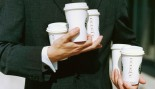Man Holding Coffee Cups thumbnail