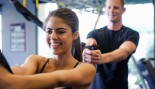 man and woman working out together at gym thumbnail