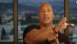 Dwayne Johnson pretending to strangle a man.  thumbnail