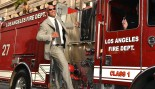 Dwayne Johnson hangs off the side of a fire truck.  thumbnail