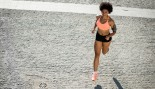 Woman running in street thumbnail