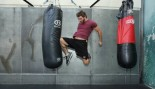 man throwing knee kick at heavy bag thumbnail