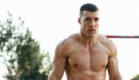 Fit young man doing dips on parallel thumbnail