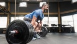 Man Deadlifts in Gym thumbnail