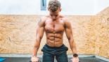 Man Preparing for the Push-ups on Kettlebells in Gym thumbnail