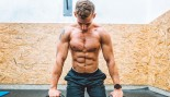 Man Preparing for the Push-ups on Kettlebells in Gym thumbnail