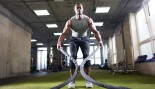 Man Working Out With Battle Ropes in Gym thumbnail