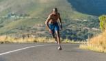 Man sprinting down the road.  thumbnail
