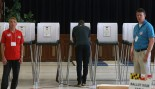 Man voting in polling booth during election thumbnail