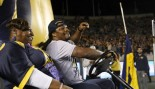 Marshawn Lynch drives a golf cart at a Call football game thumbnail