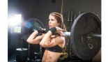 Woman lifting barbell. thumbnail
