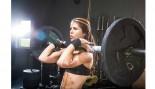 Woman lifting barbell. thumbnail