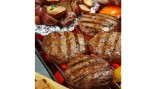 burgers and potatoes on the grill thumbnail