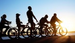 Active Men And Women Biking Along Water  thumbnail