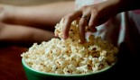 Woman Eating Popcorn thumbnail