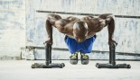 Man performing pushups with stands thumbnail
