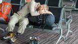 Man Sleeping At Airport thumbnail