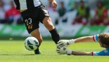 Soccer player attempts to avoid defender on shot attempt.   thumbnail