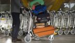 stacked luggage at airport thumbnail