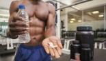 man taking supplements at gym thumbnail