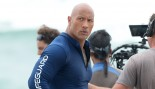 Dwayne Johnson walks on the beach on the set of Baywatch.  thumbnail