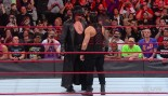 The Undertaker stares down Roman Reigns. thumbnail