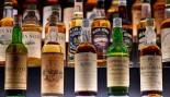 Whiskey bottles at a bar.  thumbnail