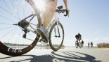 Woman riding bike thumbnail