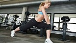 woman stretching her legs in gym thumbnail