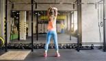 Woman in Gym Lifting Kettlebell thumbnail