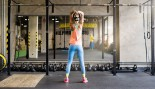 Woman in Gym Lifting Kettlebell thumbnail