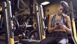 Woman On The Phone In The Gym  thumbnail