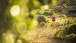 Woman Trail Running Outdoors In Tank and Shorts  thumbnail