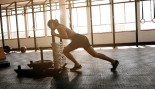 Woman Working Out With Sled Pushes thumbnail