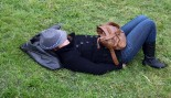 Woman sleeping in the grass.  thumbnail