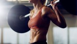 Woman Holding Barbell in Gym thumbnail