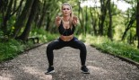 Woman Squatting Outdoors thumbnail