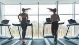 Women Running on a Treadmill in the Gym thumbnail