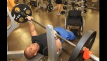 Double Amputee Flexes His Muscle in the Weightroom thumbnail