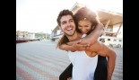 Young man carrying woman on his back thumbnail