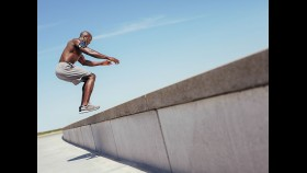 Man Jumping On Ledge For Exercise thumbnail
